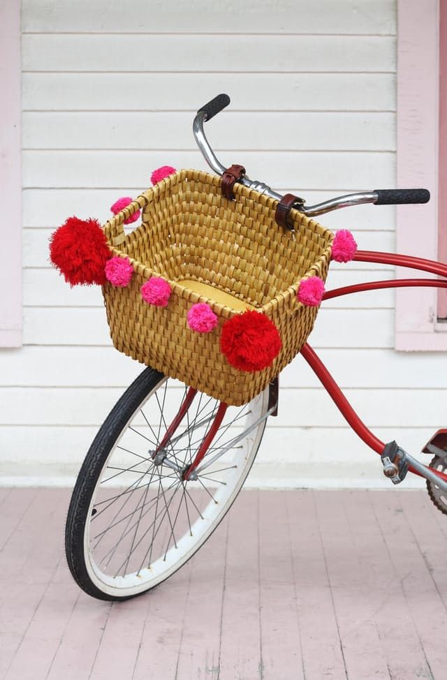"""There are plenty of bicycle baskets on the market that are both affordable and attractive, but if you're a """"ride or DIY"""" type —this project is for you. It's easy, super affordable, and the best part: your look will be one of a kind!"""