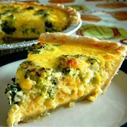 Easy Broccoli Quiche  2 tablespoons butter  1 onion, minced  1 teaspoon minced garlic  2 cups chopped fresh broccoli  1 (9 inch) unbaked pie crust   1 1/2 cups shredded mozzarella cheese  4 eggs, well beaten  1 1/2 cups milk  1 teaspoon salt  1/2 teaspoon black pepper  1 tablespoon butter, melted