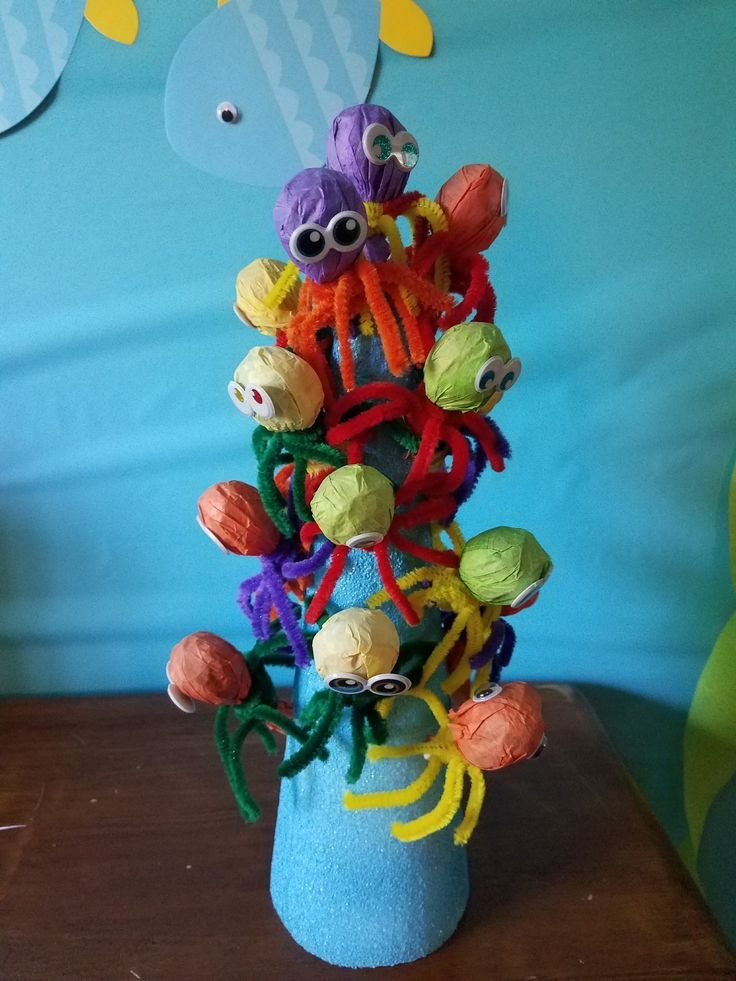 The materials you will need for this project are: Tootsie Roll Lollipops Tissue Paper Assorted Colored Pipe Cleaners Googly eyes, or eye stickers Stickers (Optional) Items you need for the display …
