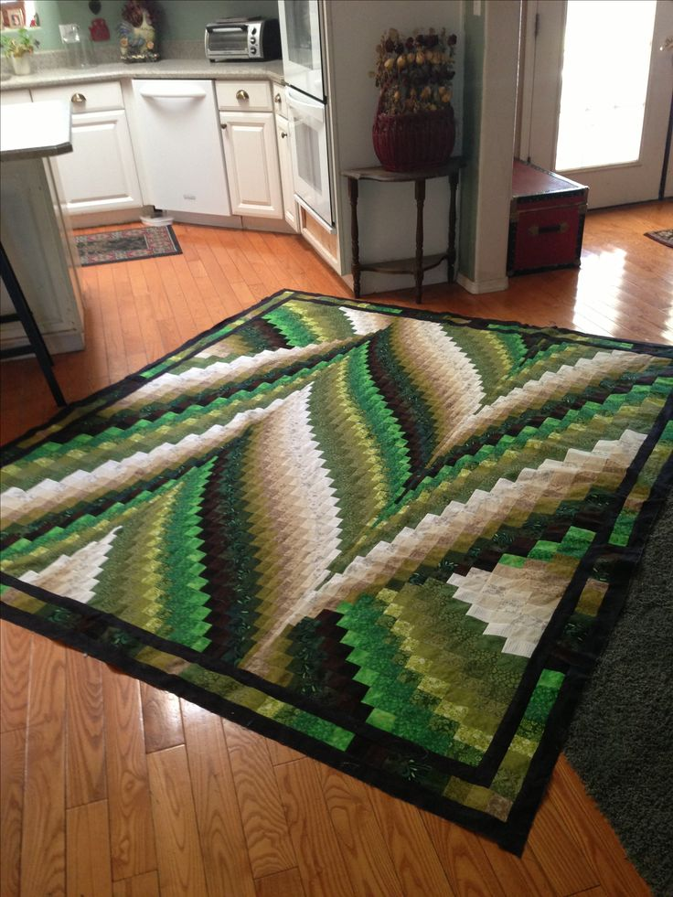 Bargello BARGELLO- On Eagles Wings-- I made this as a fundraiser quilt for my daughters school.  They will be ruffling it off.   I think it turned out great.   It is made from the Delightful Peaks pattern