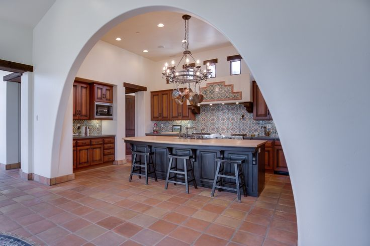 Traditional kitchen with terracotta tile floors mexican for Traditional mexican kitchen