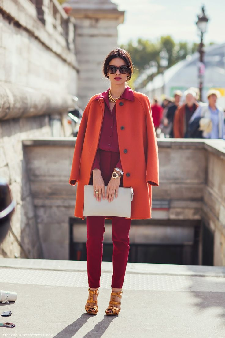 beautiful mix of colour with bordeaux red and oversized rich orange coat #style
