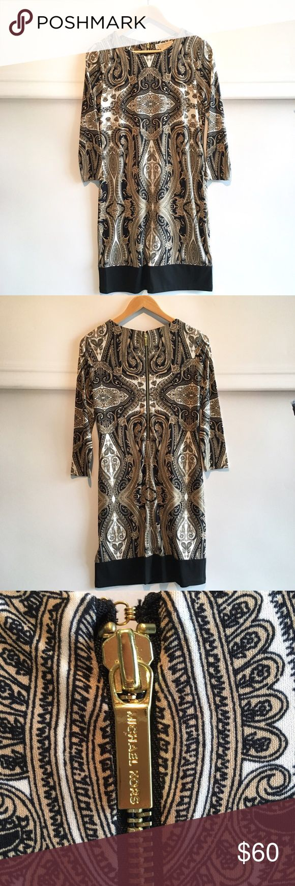 """Micheal Micheal Kors toffee print dress NWT Flat lay chest 17"""", shoulders 13.75"""", sleeves 18.5"""", length 35.5"""". NWT. Gorgeous printed dress in toffee, black, and cream. Perfect for a wedding or a night out! MICHAEL Michael Kors Dresses Midi"""