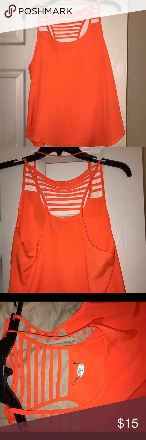 Ali & Kris Neon Orange Strappy Top Tank Top Ali & Kris Neon Orange Strappy Top Tank Top beautiful and can be worn anywhere with anything. 100% Polyester Size Small Urban Outfitters Tops Tank Tops