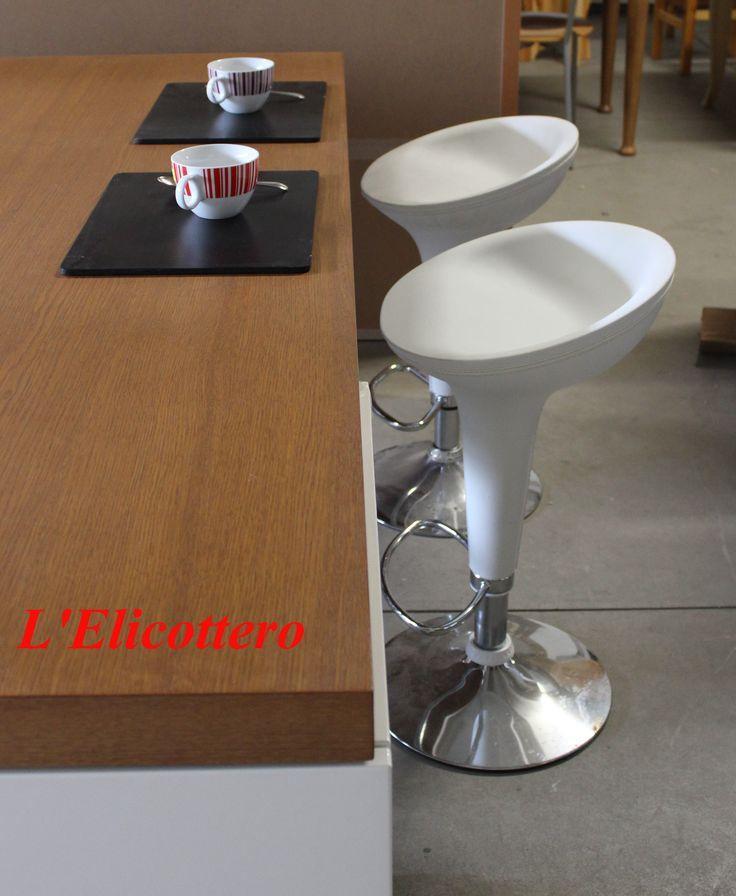 White peninsula stools. www.lelicottero.com