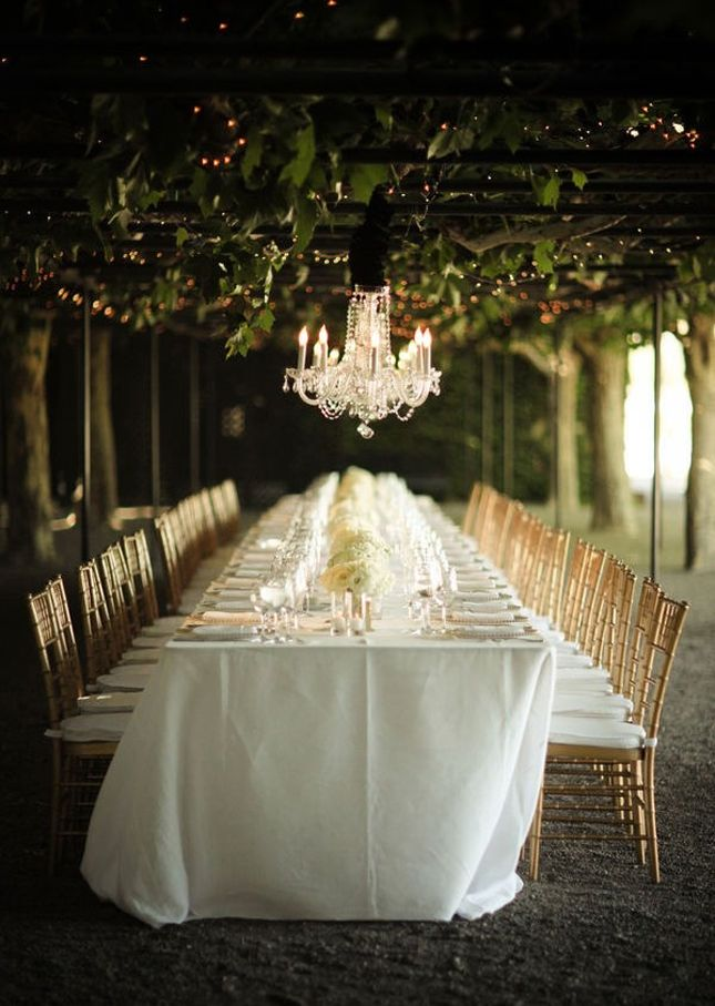 a crystal chandelier and gold chiavari chairs take a simple white decor to a whole new level...