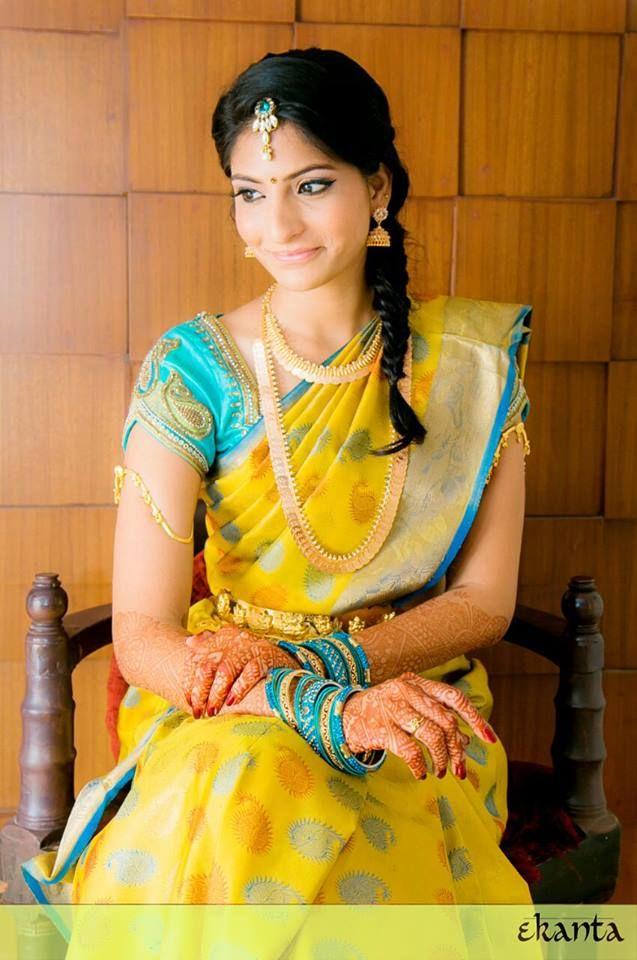 South Indian bride. Temple jewelry. Jhumkis. Yellow and blue silk kanchipuram sari.Braid with fresh jasmine flowers. Tamil bride. Telugu bride. Kannada bride. Hindu bride. Malayalee bride.Kerala bride.South Indian wedding.