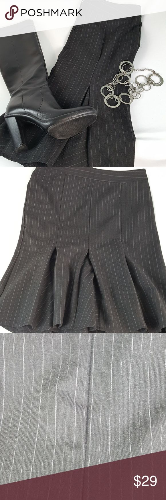 "United Colors of Benetton Pinstriped Gray Skirt Perfect for career wear wardrobe, this is a quality fit n' flare skirt with pleated bottom by Benetton. Light stretch for flexible fit. Size 6 (EUR 42).   Waist: 15.5"" Hips: 18"" Waist to Hem: 23"" * measurements are taken flat and are APPROXIMATE *  ALL ITEMS FROM A SMOKE-FREE HOME   #M15 GWB-100 United Colors Of Benetton Skirts"