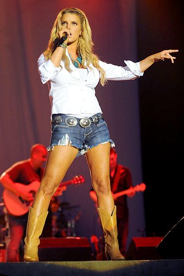 """While still dating Tony Romo, the """"Come On Over"""" singer showed off her tanned legs in short shorts at the 16th Annual Country Thunder concert series in Twin Lakes, Wisconsin."""