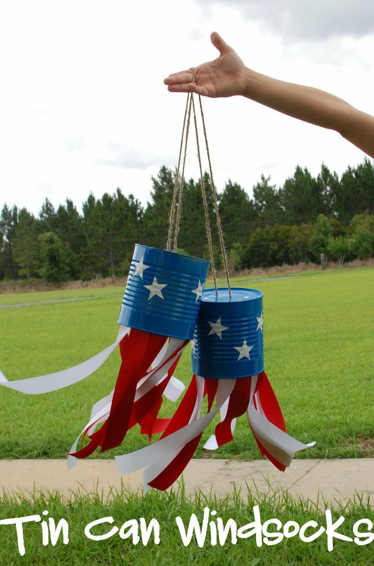 Pre-paint the cans with a blue spray paint and then let the kids paint stars on with white paint and sponges. Hot glue on the ribbon.