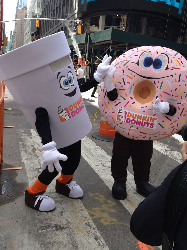 Cuppy and Sprinkles high-fiving in Times Square, NYC on National Donut Day!