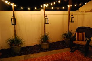 2 x 4's and painted them a distressed brown, cemented them in the pots.Once cured, added some plant hangers and hung the lanterns.The patio desperately needed more ambient lighting so I picked up some bulb lights;We attached them to the top of the posts and ran them back to the house.