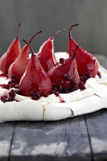 Pavlova with poached pears and pomegranate recipe on www.nomu.co.za
