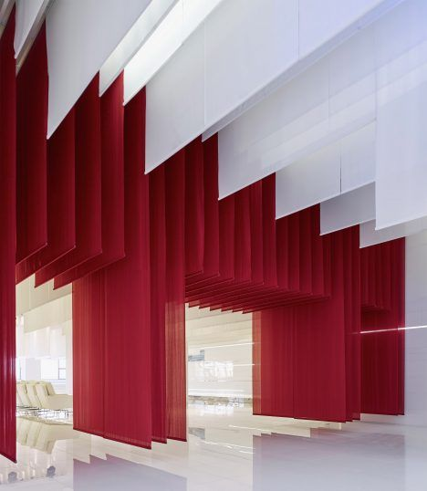 This museum of vintage BMWs by architecture practice Crossboundaries is draped in layers of red fabric that reference traditional Chinese archways.
