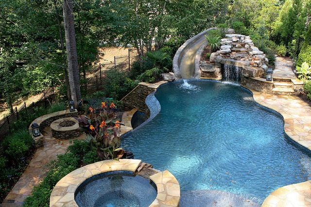 I want this pool with slide, waterfall and grotto cave to be in backyard! if only....