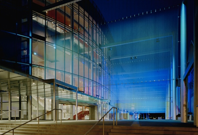 Marion Oliver McCaw Hall featuring Cascade Coil wire mesh architectural panels with colored lighting for a dramatic effect.