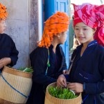 The Pa-O women of Burma. Turban is wool in orange or red plaid, and sometimes a terry cloth towel is worn as a turban. According to Pa-O legend, once upon a time the dragon mother laid three eggs: the first gave birth to the Karen people, the second to the Pa-O people, and the third to the Karenni and Padaung. Out of respect to this legend, the Pa-O women style their turban like a dragon's head.