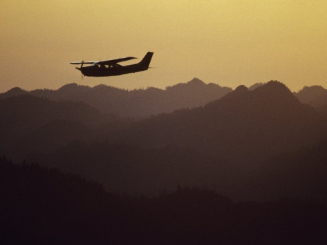 A Cessna 210 Soars Above Olympic National Forests Shelton and Quinault Ranger Districts*