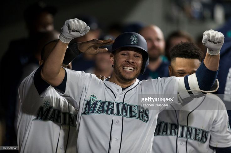 Danny Valencia #26, of the Seattle Mariners celebrates hitting solo home run off of starting pitcher Matt Shoemaker #52 of the Los Angeles Angels of Anaheim during the sixth inning of a game at Safeco Field on May 2, 2017 in Seattle, Washington.