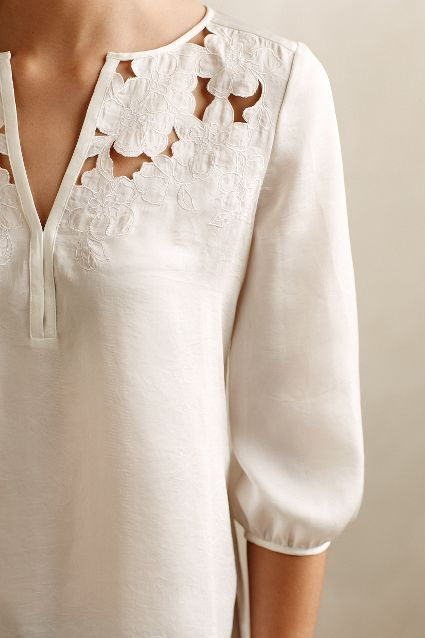 I love white silk, and this floral cut out motif is beautiful. Cut Flower Peasant Blouse - anthropologie.com