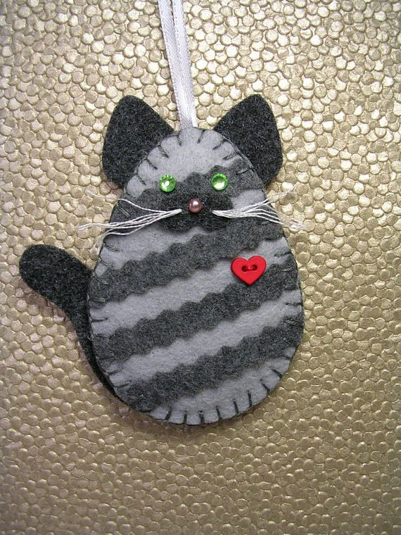 This charming gray tabby kitty cat measures approx. 4 high x 4 wide. It is hand cut and sewn and lightly padded with fiberfill. The cats listed are my own design and are an artistic abstract interpretation of certain breeds. For the striped tabby, I have placed the stripes on the diagonal to
