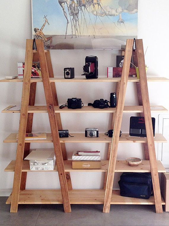 You could even use ladders to support planks for a simple and trendy DIY shelf. | 27 Insanely Clever Ways To Display Your Books