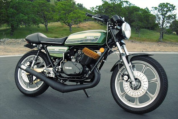 """If the Yamaha SR400 is the easy-going, easily swayed favorite of café racer builders, the two-stroke Yamaha RD400 is its delinquent half-brother. It was launched in 1976 as a slightly more refined version of the RD350 firecracker, but was still a quick, nervous bike to ride. (As the Used Motorcycle Guide said, """"If it doesn't…KILL YOU IT DONT BELONG IN 2 TOKES"""