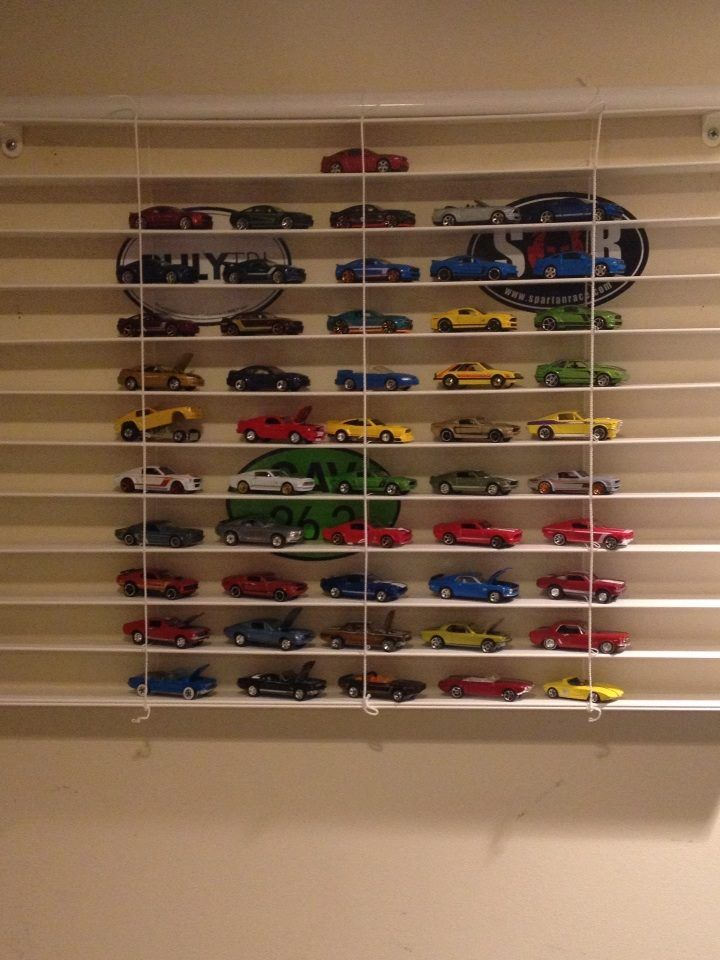 Matchbox Car Display re-purposing blinds that have been cut to fit the window.