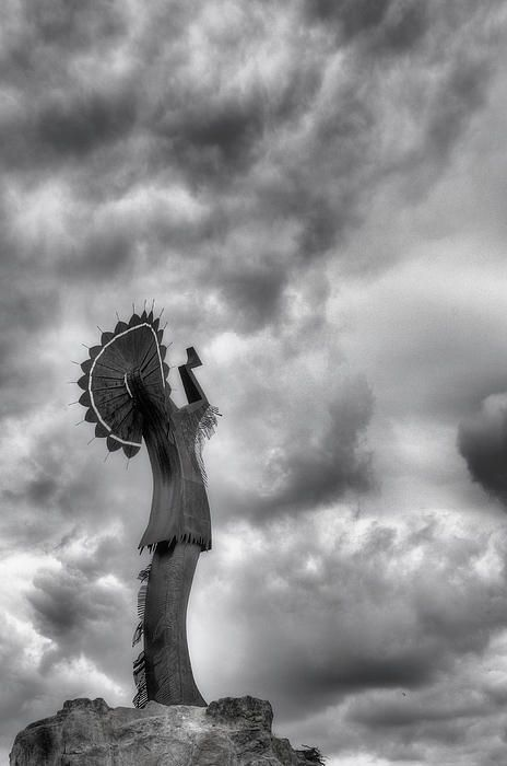 The Keeper of the Plains stands watch over Wichita Kansas as storm clouds billow. US