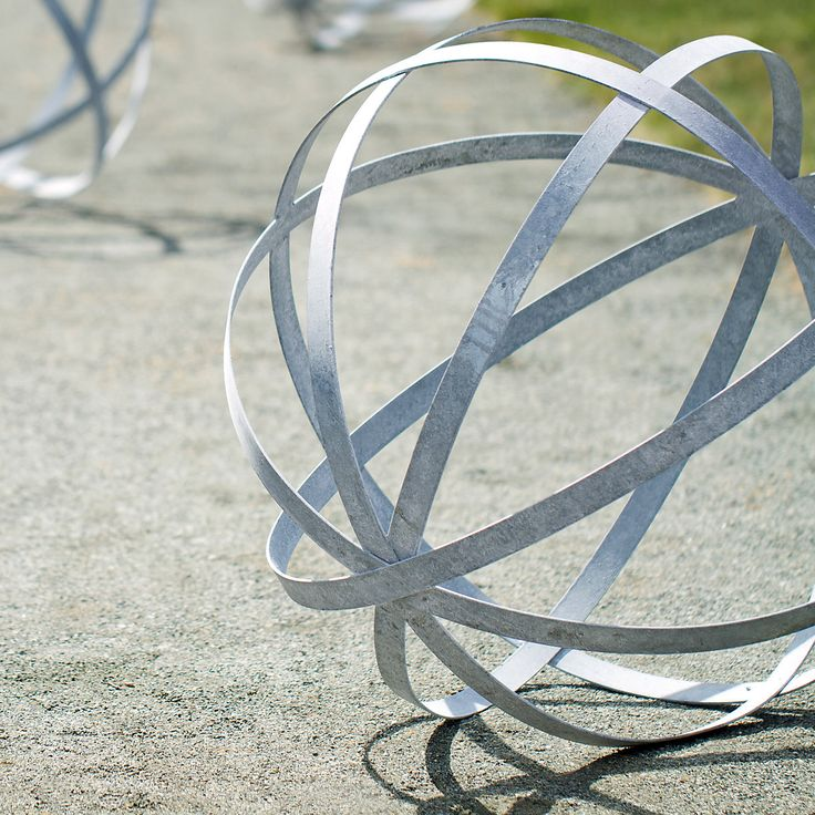 Sculpture Garden: The Meridian Sphere, hand-forged in Philadelphia by a friend of terrain. | Image via: shopterrain.com