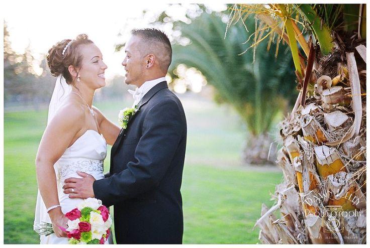 Bride with messy bun and diamond clip at Chez Shari golf course in Manteca California