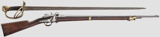Mle 1856 'Arcelin' Cavalry Musketoon with sword-bayonet    Manufactured by the Manufacture d'Armes de Châtellerault in France c.1856.  Chambered for 12mm paper cartridges primed with an external percussion cap, bolt action with spring-loaded folding bolt handle, single-shot.  The bayonet is 109cm long, or only 9cm shorter than the carbine itself, and features a double-fullered backsword-type blade ending with a false edge. The guard has three brass bars and a knuckle bow.