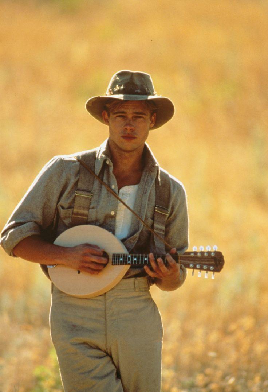 Brad Pitt playing his ukelele on the set of A River Runs Through It.