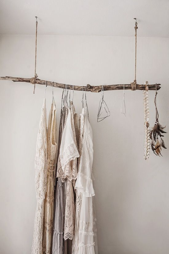 Garment rack made out of a stick - Great for if you have a small closet. #apartment #home #organize #closet #bedroom