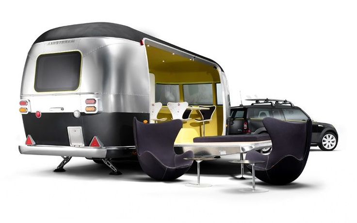 A retro Airstream trailer w/ riffs on the Egg Chair, accompanied by a Mini Cooper!