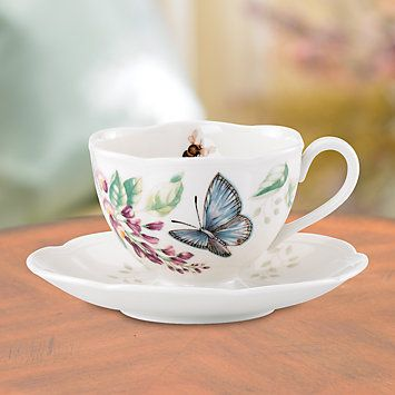 A blue butterfly flutters on this white porcelain cup that captures the beauty of butterfly meadows. Both the cup and its matching saucer have gently scalloped edges, adding to the dainty design. Colo