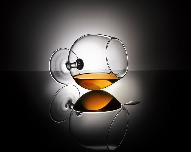 Brandy - hold the glass in this horizontal position, take a peel of an orange and squize the oil it contains into the brandy, while you hold a burning lighter onto the squized oil...What you get is an orange flavoured brandy... Delicious !