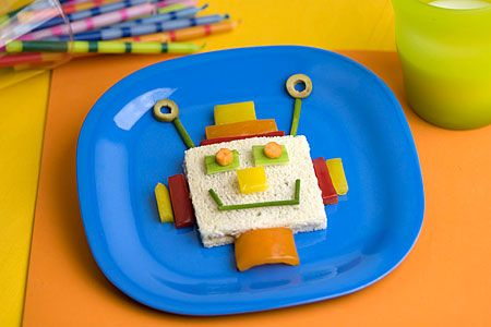 """Having a robot themed party?  Or maybe your kids just love Robots.  Well, here is a fun food to serve and the jkids can even make their own Robot sandwich.  Plan a """"Make your own Robot sandwich"""" party and just set out one example with some food items already cut into pieces.  Give each child the basic sandwich and let them create with food!  Such fun!"""