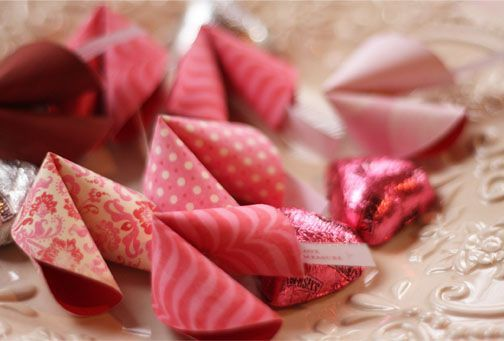 Patterned paper fortune cookies with valentine messages in them