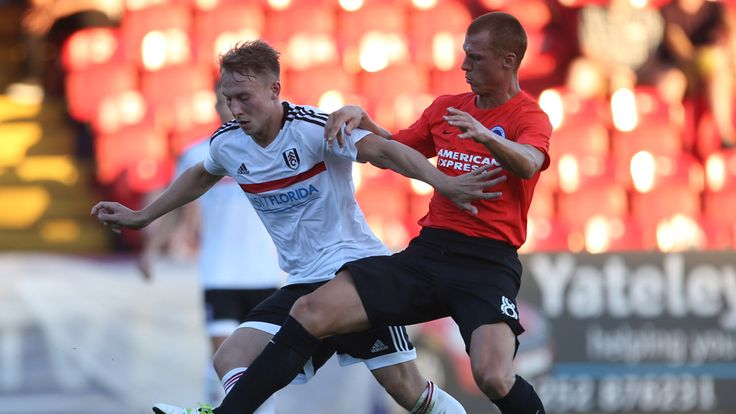 Fulham wearing the new kit, winning 3-0 in a friendly against Brighton, a familiar face Steve Sidwell putting in a tackle.