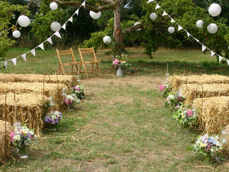 Just waiting for the guests... jam-jar posies as pew ends for a farm wedding.  English country wedding flowers by Common Farm Flowers in Somerset