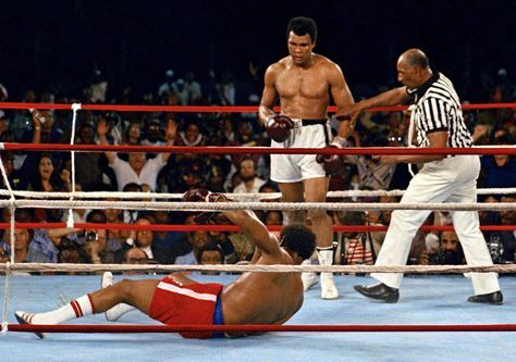 "October 30, 1974 Muhammad Ali defeats George Foreman in Kinshasa, Zaire to regain his heavyweight crown in a fight billed as ""The Rumble in the Jungle."" In addition to the fight being the first heavyweight title fight held in Africa, it is the 14thAnniversary of Ali's professional boxing debut."