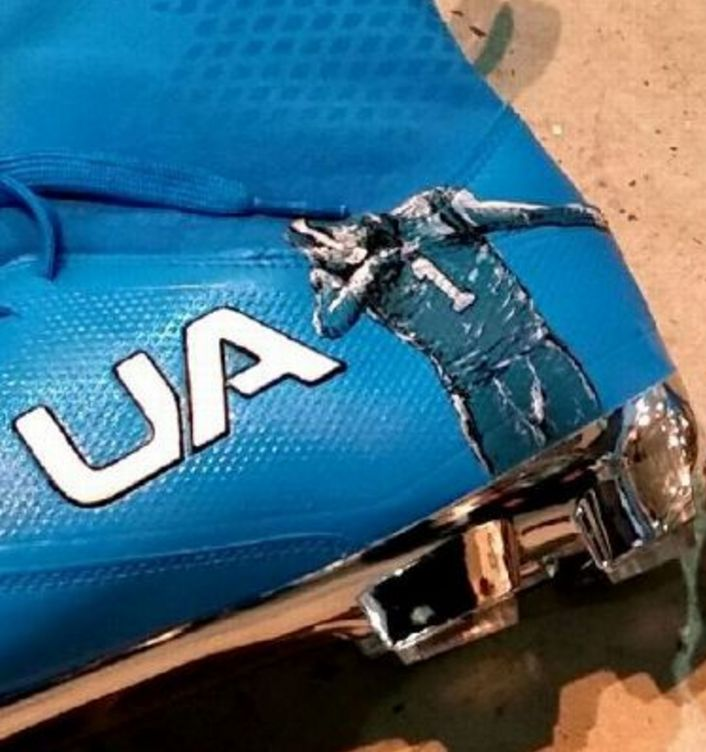 Under Armour designed Cam Newton's Thanksgiving cleats to show off his touchdown Dab dance.