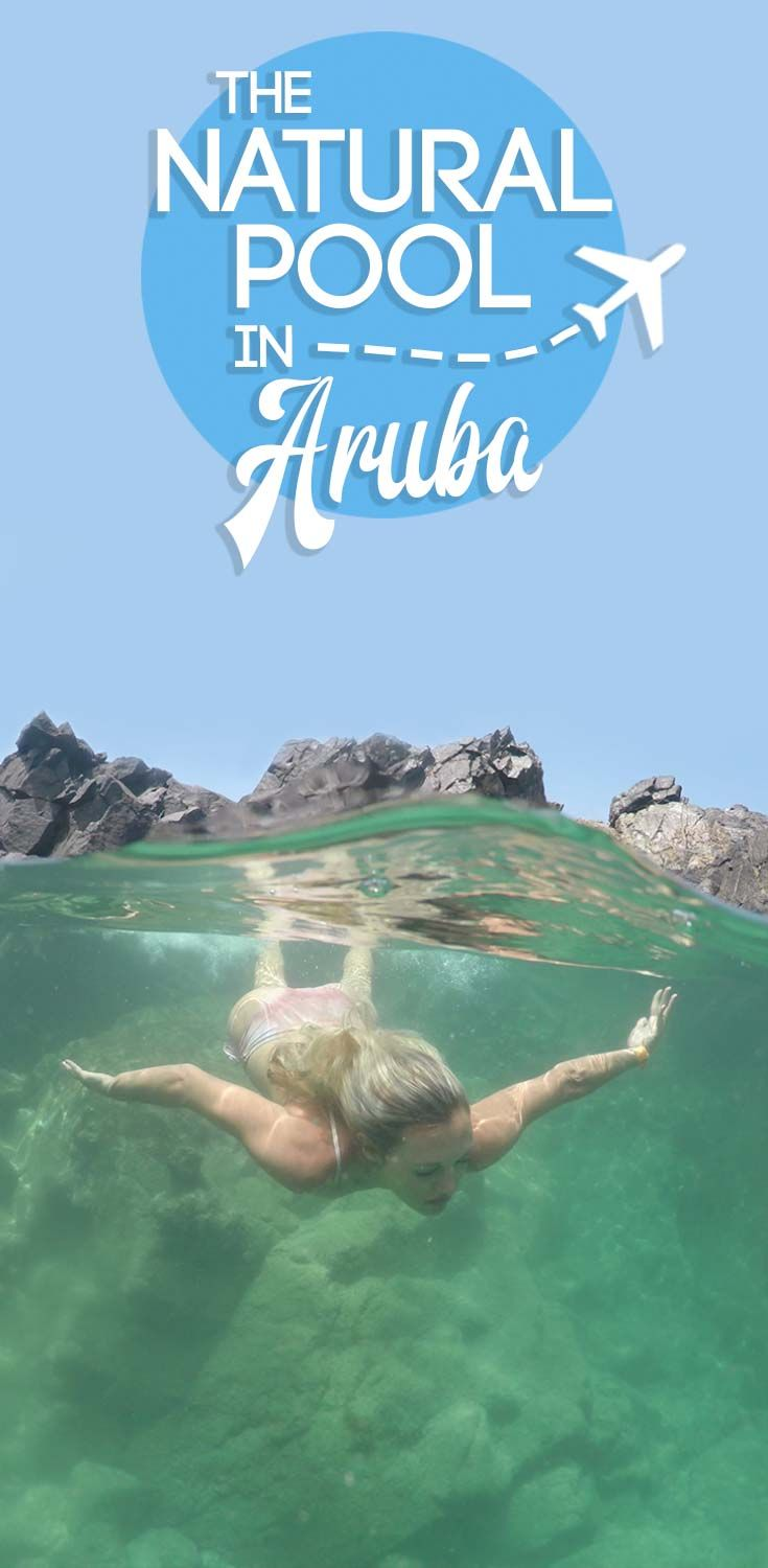 On the windswept eastern shores of #Aruba is a crystal clear emerald pool just begging to be jumped into. Most locals call it the Aruba Natural Pool, or the #Conchi Natural Pool. You'll find this unique swimming hole in the Arikok National Park and it's a one of a kind adventure waiting for you in Aruba || Getting Stamped - Couple #Travel & #Photography #Blog
