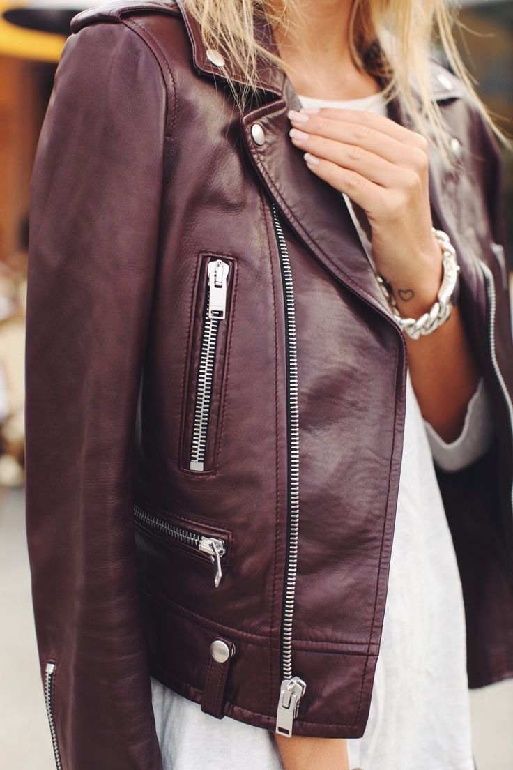 Love this burgundy leather jacket over fresh winter white dress