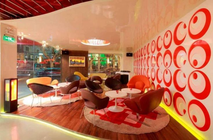 http://taizh.com/wp-content/uploads/2014/10/homey-lounge-cafe-design-with-red-art-circle-on-the-wall-and-colorful-chair-and-small-white-round-table-on-the-white-red-round-rug-along-with-lighting-ceiling-as-well-wooden-floor.jpg