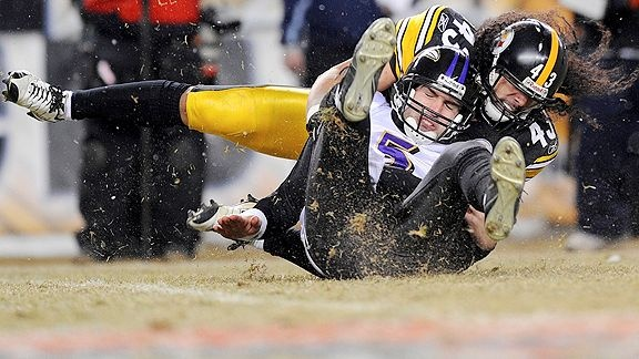Flacco (QB) of the Ravens is sacked by Troy Polamalu (SS) of the Steelers.