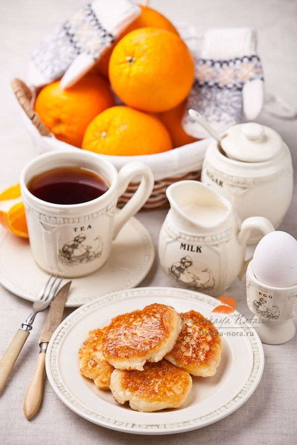 Tea with Syrniki (Russian cottage cheese pancakes/fritters) by Natalia Lisovskaya