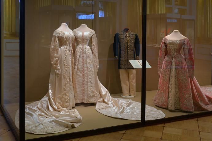 Olga and Tatiana's court dresses on display together (Olga's is the one on the left, Tiatiana's is the one on the right) with another court dress