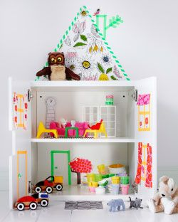 Use washi tape to accent a plain bookshelf for a temporary and changeable doll house. like building a fort rather than buying a playhouse. (Shown from ikea, STUVA storage combination with doors used as a doll's house)